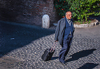 Urban Street Photography. The eyes of this religious clergyman caught my attention. He was walking down one of the cobblestone streets in Rome Italy.