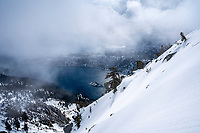 Cody Townsend skiing above Emerald Bay as a storm blows in. Lake Tahoe, CA