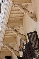 Zanzibar, Tanzania.  South Asian Influence in Architectural Design, Stone Town.  Elephant Head Supports Overhead Balcony.