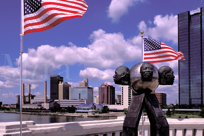 Rev. Martin Luther King sculpture on the Martin Luther King Memorial Bridge over the Maumee River, skyline of Toledo, Ohio.