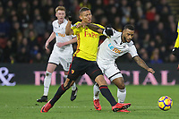 (L-R) Richarlison of Watford challenges  Luciano Narsingh of Swansea City during the Premier League match between Watford and Swansea City at the Vicarage Road, Watford, England, UK. Saturday 30 December 2017