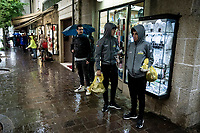 Mikel Nieve (ESP/Mitchelton-Scott) & Esteban Chavez (COL/Mitchelton-Scott) waiting in the pooring rain for the teamcar to pick them up and bring them back to the team hotel after the race<br /> <br /> Stage 9 (ITT): Riccione to San Marino (34.7km)<br /> 102nd Giro d'Italia 2019<br /> <br /> ©kramon