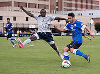 Joshua Yaro (5) of Georgetown tries to block the cross of Timo Pitter (18) of Creighton during the game at Shaw Field on the campus of the Georgetown University in Washington, DC.  Georgetown tied Creighton, 0-0, in double overtime.