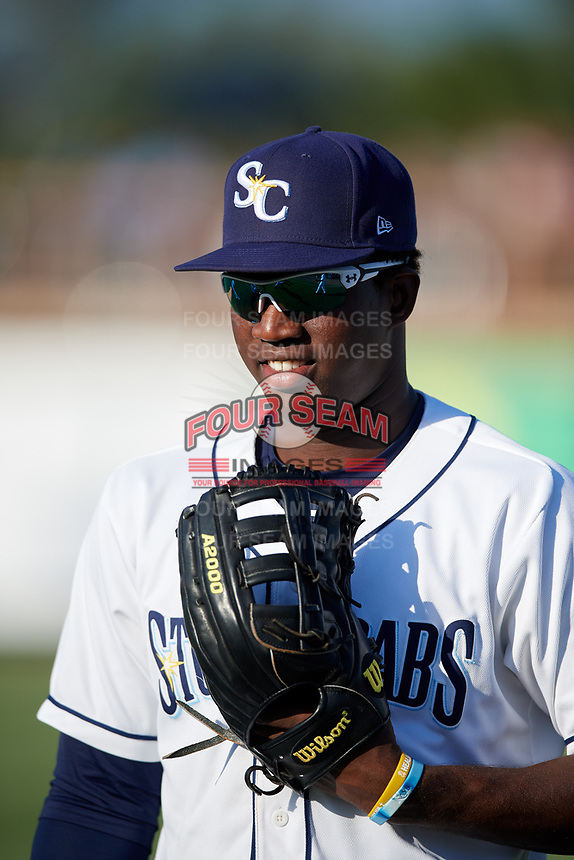 Charlotte Stone Crabs right fielder Jesus Sanchez (4) warms up before a game against the Palm Beach Cardinals on April 20, 2018 at Charlotte Sports Park in Port Charlotte, Florida.  Charlotte defeated Palm Beach 4-3.  (Mike Janes/Four Seam Images)