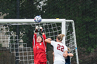 NEWTON, MA - AUGUST 29: Kaitlyn Mahoney #1 of University of Connecticut punches out a corner kick during a game between University of Connecticut and Boston College at Newton Campus Soccer Field on August 29, 2021 in Newton, Massachusetts.