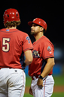 Williamsport Crosscutters hitting coach Christian Marrero (24) talks with Alec Bohm (5) during a game against the Mahoning Valley Scrappers on August 28, 2018 at BB&T Ballpark in Williamsport, Pennsylvania.  Williamsport defeated Mahoning Valley 8-0.  (Mike Janes/Four Seam Images)