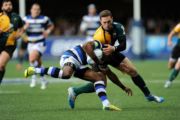 George North of Northampton Saints gets hold of Semesa Rokoduguni of Bath Rugby during the Amlin Challenge Cup Final match between Bath Rugby and Northampton Saints at Cardiff Arms Park on Friday 23rd May 2014 (Photo by Rob Munro)