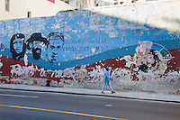 """Cuba, Havana.  Revolutionary Slogans Fade with the Passage of Time.  """"Estudio, Trabajo, Fusil"""" (""""Study, Work, Rifle""""), the political motto for Cuba's Communist Youth Union."""