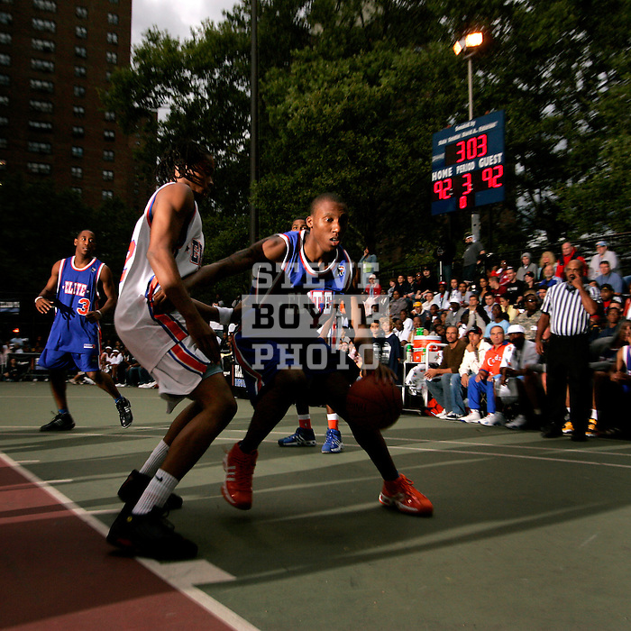 Nolan Smith (43) is defended by Chris Allen (20) during the Elite 24 Hoops Classic game on September 1, 2006 held at Rucker Park in New York, New York.  The game brought together the top 24 high school basketball players in the country regardless of class or sneaker affiliation.