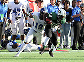 Armwood Hawks linebacker Eric Striker #19 tackles wide receiver Travius Brown #19 (green) after a reception during the fourth quarter of the Florida High School Athletic Association 6A Championship Game at Florida's Citrus Bowl on December 17, 2011 in Orlando, Florida.  Armwood defeated Miami Central 40-31.  (Photo By Mike Janes Photography)