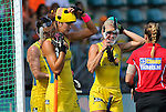 The Hague, Netherlands, June 09: Players of Australia put on their face masks before a penalty corner during the field hockey group match (Women - Group A) between England and Argentina on June 9, 2014 during the World Cup 2014 at Kyocera Stadium in The Hague, Netherlands. Final score 0-0 (0-0)  (Photo by Dirk Markgraf / www.265-images.com) *** Local caption *** Karri McMahon #11 of Australia, Anna Flanagan #9 of Australia, Casey Eastham #4 of Australia
