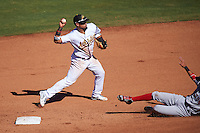 Mesa Solar Sox Franklin Barreto (4), of the Oakland Athletics organization, throws to first as Mauricio Dubon (5) slides into second base during a game against the Surprise Saguaros on October 14, 2016 at Sloan Park in Mesa, Arizona.  Mesa defeated Surprise 10-4.  (Mike Janes/Four Seam Images)