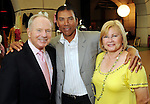 From left: Don Sanders, Jose Cruz and Zoraida Cruz at the Pink in the Park Bazaar & Brunch fundraiser at Union Station at Minute Maid Park Thursday April 29,2010.. (Dave Rossman Photo)
