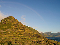 A rainbow over the Wai'anae Range (or Mountains), as seen from Ka'ena Point, O'ahu.