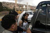 Brides and grooms in one of the three bridges that cross La Paz, Bolivia,  from East to West. This bridges are the  first place they new weds visits as soon the get married. In this indigenous  culture country  marriage is considered an  economical alliance between families, as in the old Spanish way. Crossing the bridge is a relatively new urban  tradition  meaning to cross the life as a single person and get to other end with a companion for life. All the three bridges are kind of narrow, always packed with buses and cars, so the celebration including champagne opening must be fast