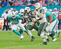 04.10.2015. Wembley Stadium, London, England. NFL International Series. Miami Dolphins versus New York Jets. New York Jets Running Back Chris Ivory runs with the ball past Miami Dolphins Safety Walt Aikens.