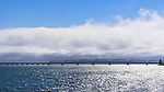 The Astoria–Megler Bridge, crossing the mouth of the Columbia River from Washington to Oregon, shown from the Washington shore with fog bank.