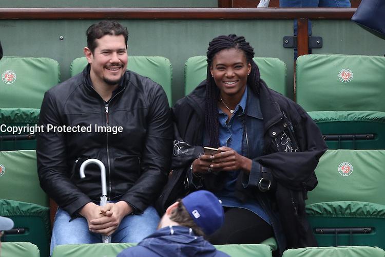 Vincent Parisi and girlfriend Muriel Hurtis watching tennis during Roland Garros tennis open 2016 in Paris on June 02 2016.