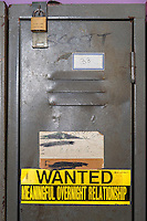 South Africa, Cape Town, Athlone.  Banner on Storage Locker in a Homeless Shelter.