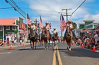 Horseback riders, Fourth of July parade in Makawao, Maui