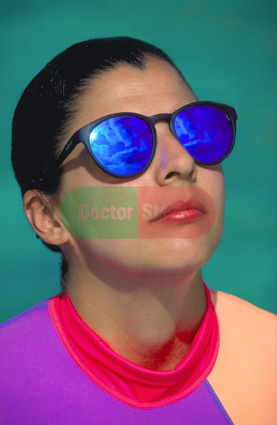 young girl wearing UV sunglasses to protect her eyes