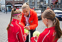 The Netherlands, Den Bosch, 16.04.2014. Fed Cup Netherlands-Japan, Street tennis on the market in the city center, with Fed Cup Team, Arantxa Rus signing autographs<br /> Photo:Tennisimages/Henk Koster
