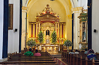 Antigua, Guatemala.  Worshipers in the Church of San Jose, formerly Santiago.