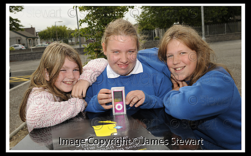 25/06/2009  Copyright  Pic : James Stewart.06_golden_bin  .::  GOLDEN BIN WINNER LAREN JARVIE, 2ND YEAR, GRANGEMOUTH HIGH SCHOOL, RECEIVES HER  HER IPOD PRIZE FROM HER HIGH SCHOOL FRIENDS :: .James Stewart Photography 19 Carronlea Drive, Falkirk. FK2 8DN      Vat Reg No. 607 6932 25.Telephone      : +44 (0)1324 570291 .Mobile              : +44 (0)7721 416997.E-mail  :  jim@jspa.co.uk.If you require further information then contact Jim Stewart on any of the numbers above.........