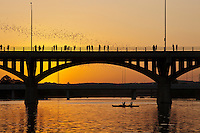 A bright orange sunset greets the Bats as they take flight from the Congress Avenue Bridge in downtown Austin, Texas.