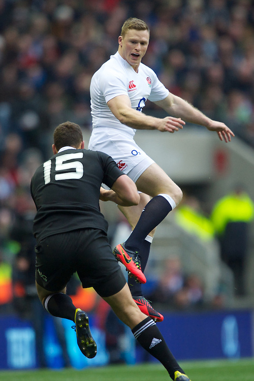 Chris Ashton of England (right) attempts to block the kick of Israel Dagg of New Zealand during the QBE Autumn International match between England and New Zealand at Twickenham on Saturday 01 December 2012 (Photo by Rob Munro)