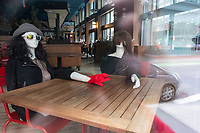"""Social distancing mannequins"" are seen inside Back Deck, a restaurant in Downtown Crossing, that has gone into temporary closure hibernation due to restrictions on restaurants put in place during the ongoing Coronavirus (COVID-19) global pandemic in Boston, Massachusetts, on Sat., Jan. 9, 2021. A Dec. 9, 2020, announcement from Back Deck and sister-restaurant French Quarter proprietor Brad Fredericks, stated, in part: ""We tried earnestly to remain open since our restart in late June, and reached a level of stabilization in October, but recently just too much damn COVID...We will continue to monitor COVID cases, vaccine implementation, returning activity in our downtown neighborhood, potential government stimulus…and will reopen when we determine it prudent. My sincere hope is that reopening will ocur while we are still in winter months. In the meantime, our social distancing mannequins will keep the seat warm for you."""