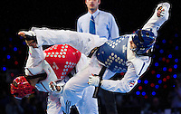 05 MAY 2012 - MANCHESTER, GBR - Aaron Cook (GBR) of Great Britain (right in blue) aims a kick at Ramin Azizov (AZE) (left in red) of Azerbaijan during the men's 2012 European Taekwondo Championships -80kg final at Sportcity in Manchester, Great Britain (PHOTO (C) 2012 NIGEL FARROW)