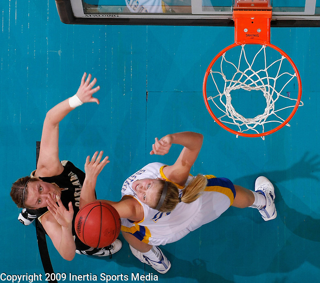 SIOUX FALLS, SD - MARCH 10:  Jessica Pike #4 of Oakland University and Ketty Cornemann #22 of South Dakota State battle for a rebound during the Summit League Women's Basketball Championship game Tuesday afternoon at the Sioux Falls Arena. (Photo by Dick Carlson/Inertia)