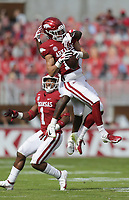 Arkansas defensive back Hudson Clark (17) intercepts a pass intended for Ole Miss wide receiver Elijah Moore (8), Saturday, October 17, 2020 during the third quarter of a football game at Donald W. Reynolds Razorback Stadium in Fayetteville. Check out nwaonline.com/201018Daily/ for today's photo gallery. <br /> (NWA Democrat-Gazette/Charlie Kaijo)