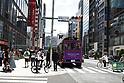 Miranda Kerr rides campaign vehicle through Tokyo shopping district