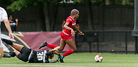 Newton, Massachusetts - October 7, 2018: NCAA Division I. Boston College (white) defeated NC State University (red), 2-0, at Newton Campus Soccer Field.<br /> Yellow Card: Alexis Bryant, instead of a red card.