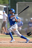 Kansas City Royals third baseman Mauricio Ramos (19) hits a home run during an instructional league game against the Seattle Mariners on October 2, 2013 at Surprise Stadium Training Complex in Surprise, Arizona.  (Mike Janes/Four Seam Images)