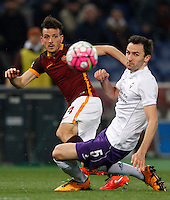 Calcio, Serie A: Roma vs Fiorentina. Roma, stadio Olimpico, 4 marzo 2016.<br /> Roma's Alessandro Florenzi, left, is challenged by Fiorentina's Milan Badelj during the Italian Serie A football match between Roma and Fiorentina at Rome's Olympic stadium, 4 March 2016.<br /> UPDATE IMAGES PRESS/Riccardo De Luca