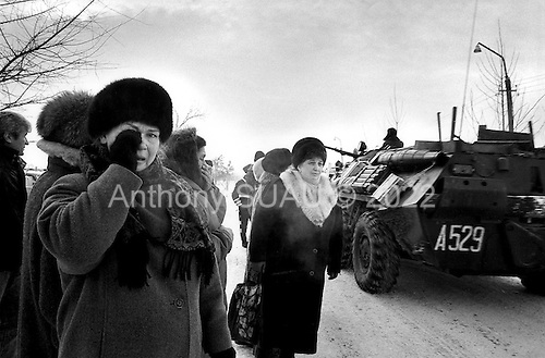 """Mozdok, Chechyna.January 1995.Russian mothers stand outside the central military camp in Mozdok in hopes of receiving word about their sons who they believe might be dead. """"They are telling so many lies""""', declares one mother."""