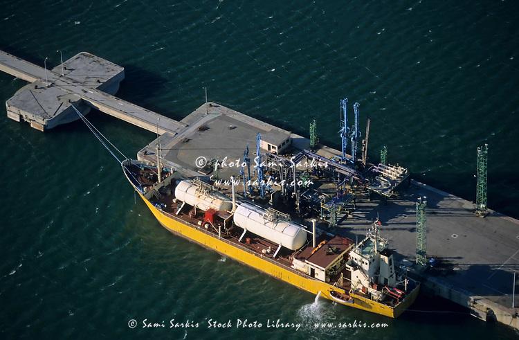 Gas tanker at wharf, France.