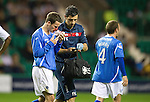 Hibs v St Johnstone...28.09.11   SPL Week.A bloodied Kevin Moon after being kicked in the face gets treatment from physio Frank Kenny.Picture by Graeme Hart..Copyright Perthshire Picture Agency.Tel: 01738 623350  Mobile: 07990 594431