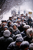 "Moscow, Russia<br /> Soviet Union<br /> December 9, 1991<br /> <br /> People line up to buy sugar during a snow storm. A typical scene from the days in the former Soviet Union. <br /> <br /> In December 1991, food shortages in central Russia had prompted food rationing in the Moscow area for the first time since World War II. Amid steady collapse, Soviet President Gorbachev and his government continued to oppose rapid market reforms like Yavlinsky's ""500 Days"" program. To break Gorbachev's opposition, Yeltsin decided to disband the USSR in accordance with the Treaty of the Union of 1922 and thereby remove Gorbachev and the Soviet government from power. The step was also enthusiastically supported by the governments of Ukraine and Belarus, which were parties of the Treaty of 1922 along with Russia.<br /> <br /> On December 21, 1991, representatives of all member republics except Georgia signed the Alma-Ata Protocol, in which they confirmed the dissolution of the Union. That same day, all former-Soviet republics agreed to join the CIS, with the exception of the three Baltic States."