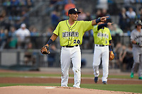First baseman Jeremy Vasquez (20) of the Columbia Fireflies asks the home plate umpire for a second opinion on a play in a game against the Augusta GreenJackets on Friday, April 6, 2018, at Spirit Communications Park in Columbia, South Carolina. (Tom Priddy/Four Seam Images)