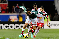 Harrison, NJ - Tuesday April 10, 2018: Rodolfo Pizarro, Sean Davis during leg two of a  CONCACAF Champions League semi-final match between the New York Red Bulls and C. D. Guadalajara at Red Bull Arena. C. D. Guadalajara defeated the New York Red Bulls 0-0 (1-0 on aggregate).