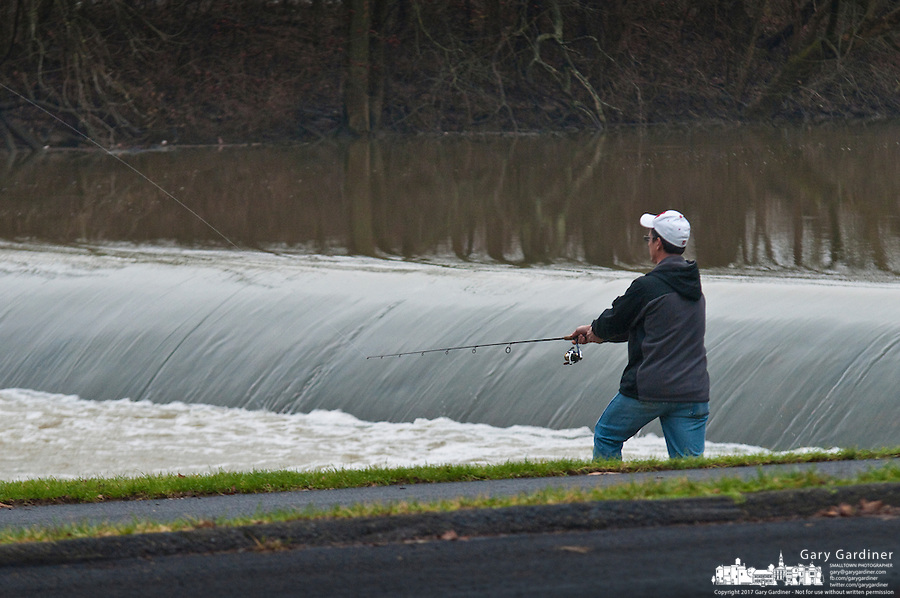 Rick Hanselman casts his line into the roiling waters below the lowhead dam on Alum Creek in Westerville, OH. Hanselman often fishes the spillway where his luck and patience are good enough to catch a few fish.