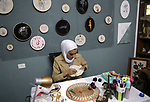 Palestinian artist Hadeel Al-Hassana 24, embroiders on fabric, at her home in the West Bank city of Hebron, on October 14, 2021. Hadeel is a graphic design graduate, and she is the owner of a project in the name of the world of Tarati. Photo by Mamoun Wazwaz