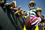 Green Bay Packers receiver Greg Jennings greets the fans after his touchdown against the Detroit Lions during the second quarter of the game at Lambeau Field in Green Bay, Wis., on Oct. 3, 2010.