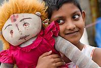 Bangladesh , Khulna district, girl Chaitee in village  Perikhali with her selfmade doll / Bangladesch , Maedchen Chaitee mit ihrer Stoffpuppe im Dorf Perikhali
