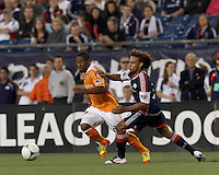 Houston Dynamo defender Corey Ashe (26) accelerates for the ball as New England Revolution defender Kevin Alston (30) defends. In a Major League Soccer (MLS) match, the New England Revolution tied Houston Dynamo, 2-2, at Gillette Stadium on May 19, 2012.