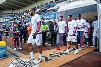 prior to the Barclays Premier League match between Swansea City and Chelsea played at the Liberty Stadium, Swansea  on April the 9th 2016 Swansea Players emerge from the tunnel with Save  our steel t-shirts on.